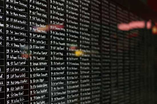 Post-9/11 veteran Ron White wrote out more than 2200 names of fallen soldiers from the Afghanistan war on Memorial Day at Chase Field in Phoenix, Arizona on May 27, 2013. (Photo by Anthony Cave, News21)