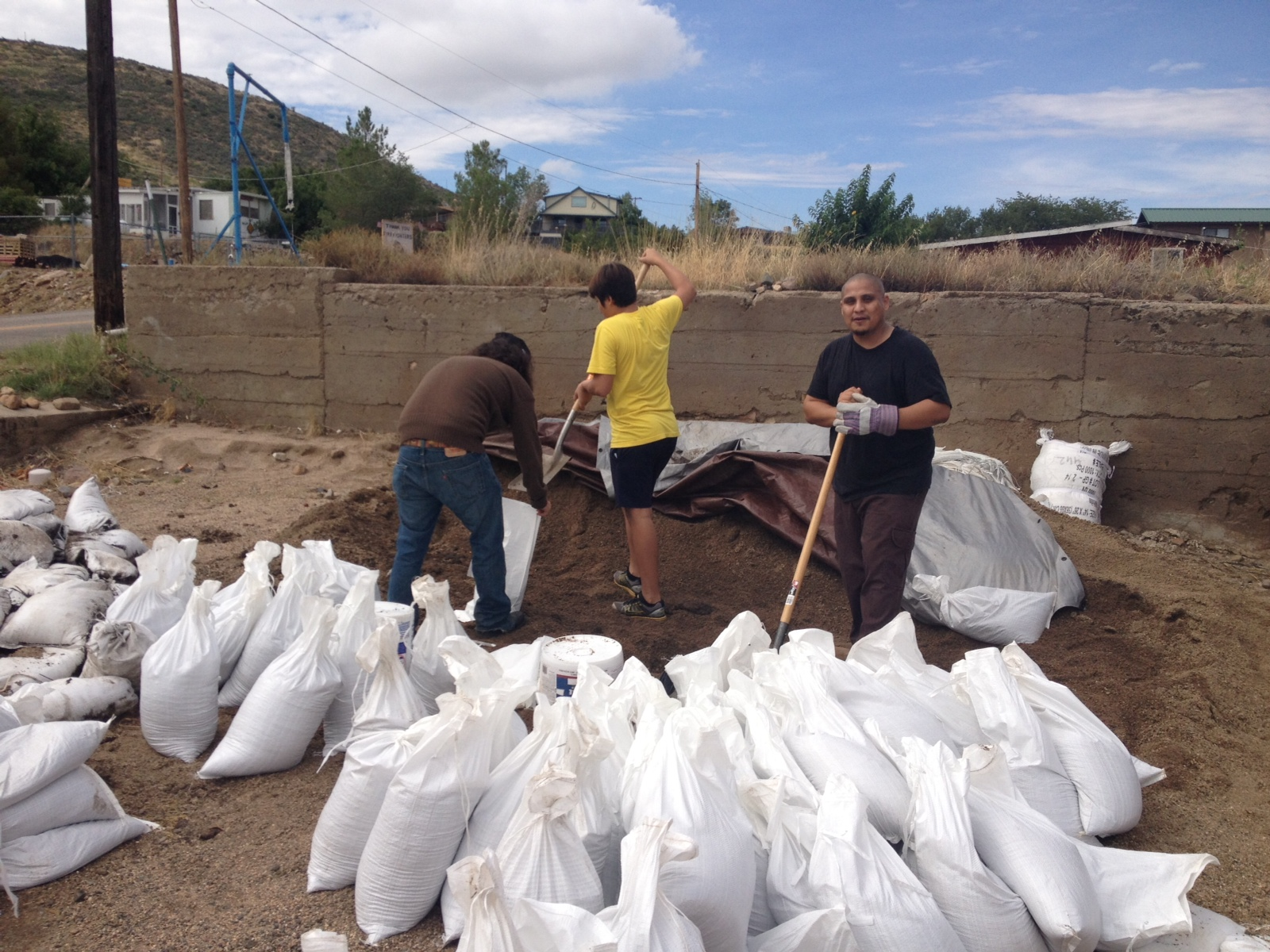 "Post-9/11 veteran Luis Camacho (far right) filled ""hundreds"" of sandbags for Yarnell, Ariz. residents facing potential flash floods. (Courtesy of Luis Camacho)"